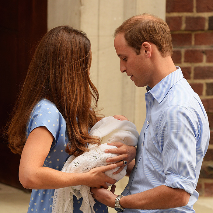 Kate gently passed her newborn son to his father outside the Lindo Wing at St. Mary's Hospital after his birth on July 22, 2013.