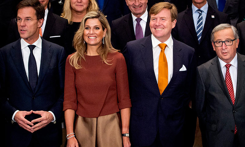 Dutch King Willem-Alexander, sporting a patriotic orange tie, and his wife Queen Maxima took their places next to Dutch Prime Minister Mark Rutte (far left) and European Commission President Jean-Claude Juncker (far right) as the Netherlands took over the rotating presidency of the Council of the European Union.