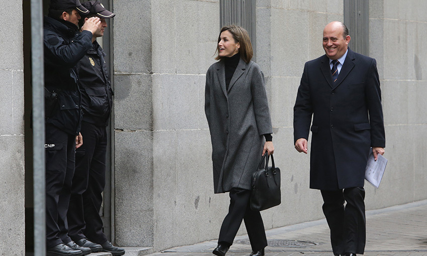 'Good morning, Your Highness!' Queen Letizia of Spain was greeted by Spanish policemen as she attended a meeting at the Spanish Society Against Cancer in Madrid.