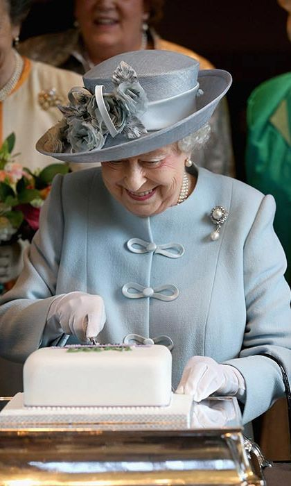 Turning 90 in 2016, Queen Elizabeth couldn't have looked more thrilled to be getting her first birthday cake of the year, three months before she hit the landmark age. The sovereign cut the iced fruit cake and enjoyed a champagne toast at a meeting of the Sandringham and West Newton Women's Institute, near her Norfolk, England home.