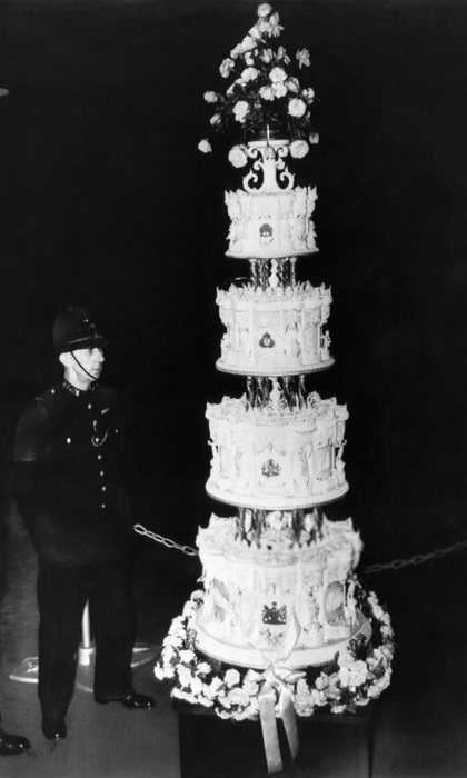 Queen Elizabeth and Prince Philip's 1947 wedding cake, seen here, was a 9-foot-tall confection – and enjoying elaborate confections continues to be a royal tradition even today. While the rest of us try to cut down on sugary treats, Europe's royal families say: Let them eat cake! 