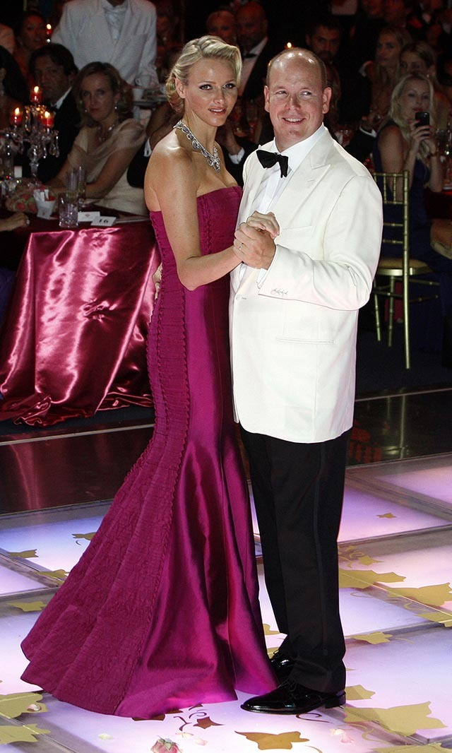 August 2011: Looking like a Hollywood star in a deep magenta gown while gracing the dance floor with Prince Albert ll at the Red Cross gala. 