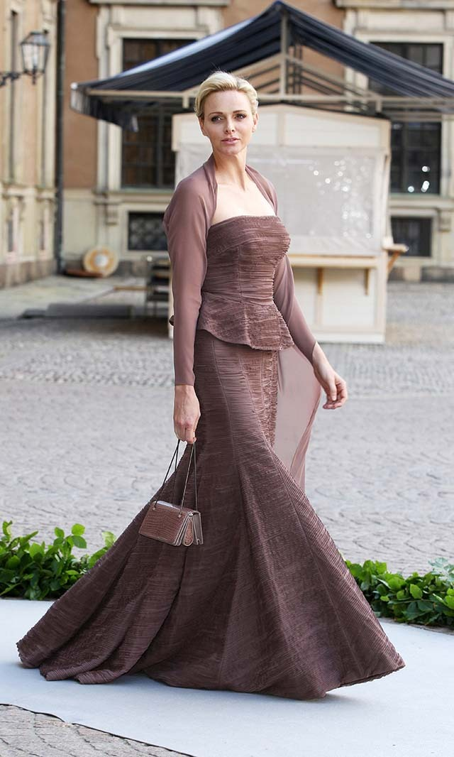 June 2013: Charlene turned heads at Princess Madeleine and Christopher O'Neill's wedding in a taupe gown by one of her favorite designers, Akris.