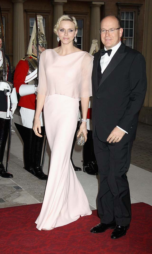 May 2012: Charlene slipped into an elegant pale pink ensemble for a dinner party hosted by Prince Charles and Duchess Camilla. 