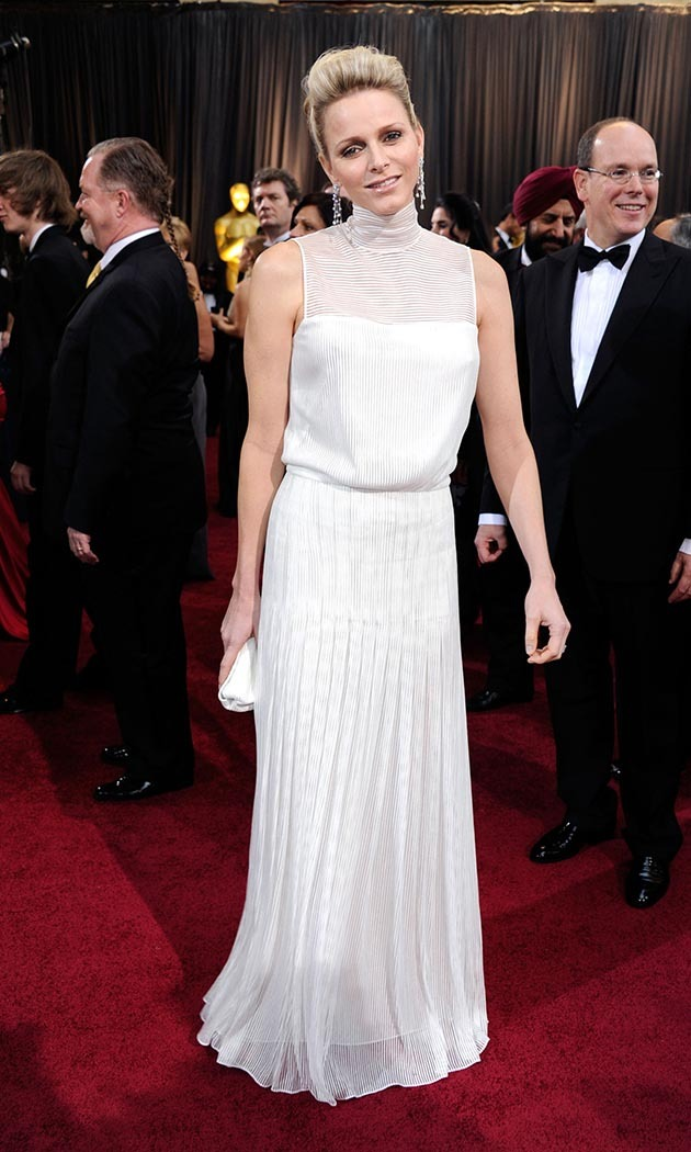 February 2012: Attending the Academy Awards in a high-necked white gown by Akris. 