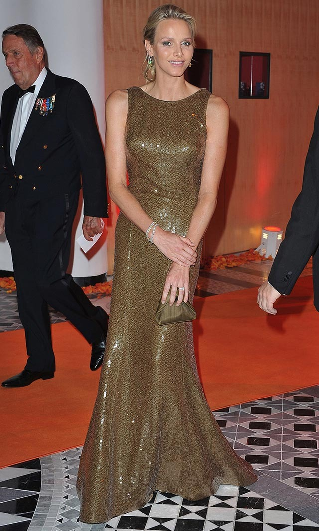 May 2011: Charlene wowed at a Formula One gala dinner in Monaco in this glittering metallic dress.