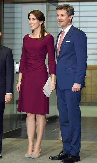 Wearing grey swede shoes and a burgundy above-the-knee dress as she joined husband Crown Prince Frederik at Akasaka Palace in Tokyo.