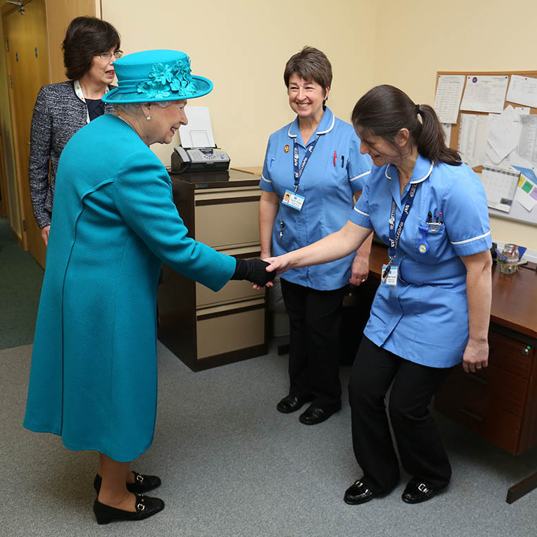 Nurses Sarah Wallis and Daniela Reynolds got a chance to practice their curtsey skills with Queen Elizabeth at The Norfolk Hospice in Hillington, England. 