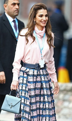 Queen Rania of Jordan gets a jump start on spring pastels at a London meeting. 