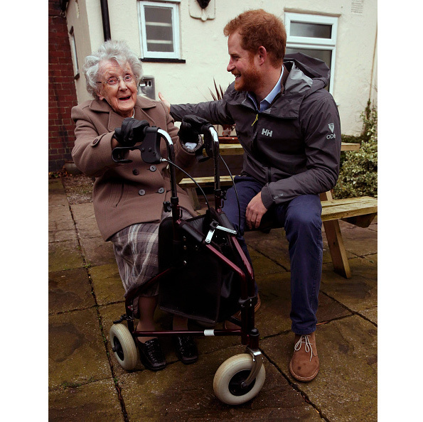 Who's charming who? Prince Harry and 97-year old Winifred Hodson seemed to do some major bonding as the royal saw the impact of the floods in the village of St Michael's on Wyre, England. 