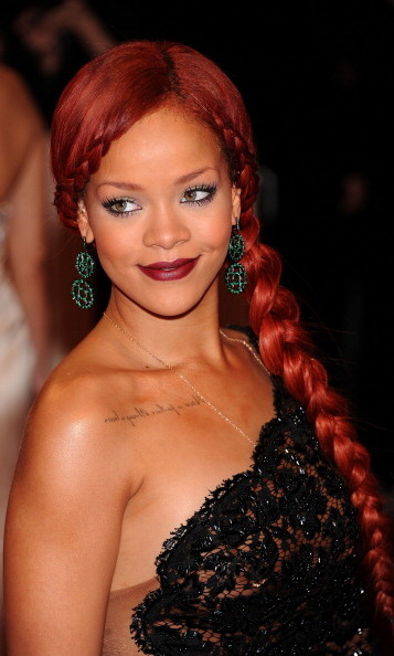Rihanna styled her fiery hair into a side braid for the 2011 Met Gala.