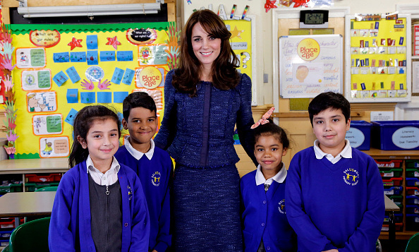 Duchess Kate has class! Here she is with students Nimra, 10, Ryan, 10, Bailey-Rae , 7, and Connor, 11, from Salusbury Primary School in Queen's Park, London, during filming of a video message for Children's Mental Health week. 