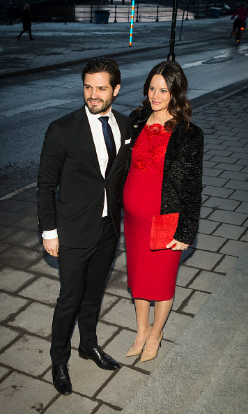 Princess Sofia wore a figure-hugging red dress to the Royal Swedish Academy of Fine Arts' formal gathering with husband Prince Carl Philip. 