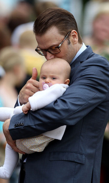 July 2012: My heart belongs to Daddy: Prince Daniel gives his little girl kisses during Crown Princess Victoria's 35th birthday celebration in Borgholm. 