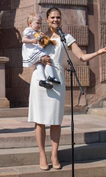 June 2013: Stealing the show, little Estelle helped her mother greet onlookers during the National Day Celebrations at the Royal Palace in Stockholm. 