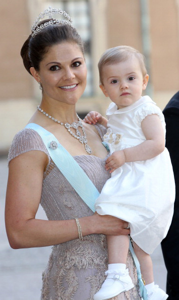 June 2013: Royal chic: Princess Estelle and Crown Princess Victoria were all dressed up during Princess Madeleine of Sweden and Christopher O'Neill's wedding at the Royal Palace. 