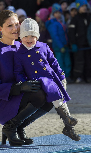 March 2014: Wearing purple to match her mom, adorabel Estelle hammed it up for the cameras during the Name Day celebrations at the royal palace. 