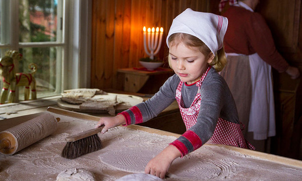 December 2015: Princess Estelle looked all grown up as she helped her mom and dad bake traditional Swedish flatbreads for Christmas.