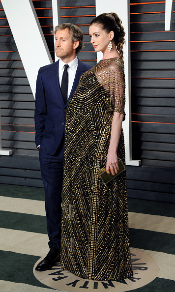 Anne Hathaway let her gown do all the talking and kept her hair in a fishtail high braid during the Vanity Fair Oscars party.