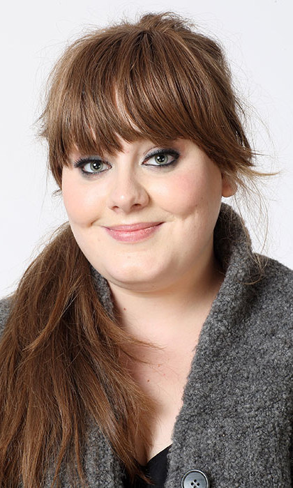 A fresh-faced 19-year-old Adele posed for a portrait session in London. The young singer sported blunt bangs and a long dark brown ponytail.