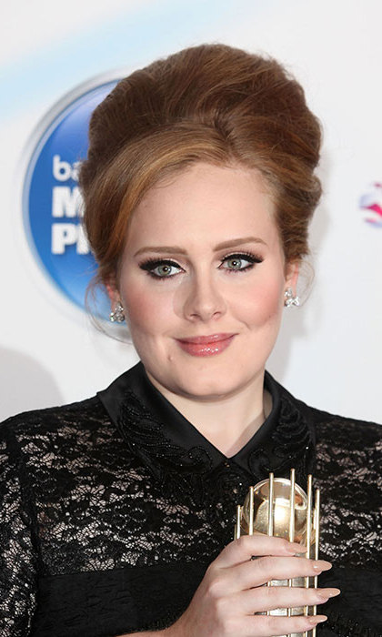 "Keeping her big hair, Adele swept her brunette locks up into a beehive to attend the Mercury awards in 2011. The singer wore her signature cat eye liner. ""I love my eyes, so I make them big,"" she told People.