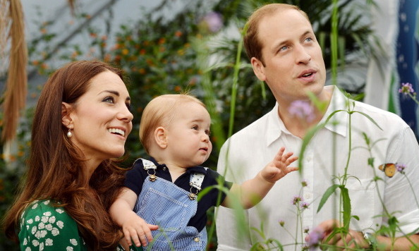 July 2014: Prince William and Duchess Kate explored a garden with a curious George.