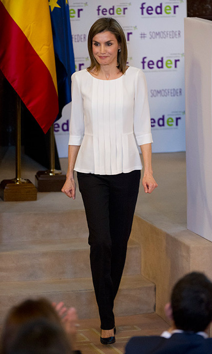 Queen Letizia kept it simple in monochrome to attend the rare diseases world day event in Madrid.