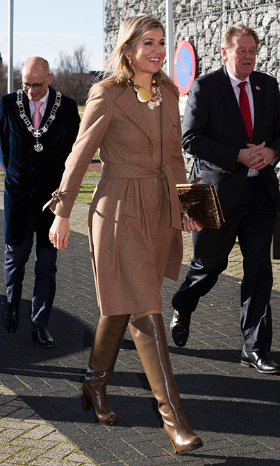 Queen Maxima of The Netherlands was all smiles as she attended the Women Inc. gender sensitive health care seminar, sporting a statement necklace and a camel wrap coat.<br /><br />