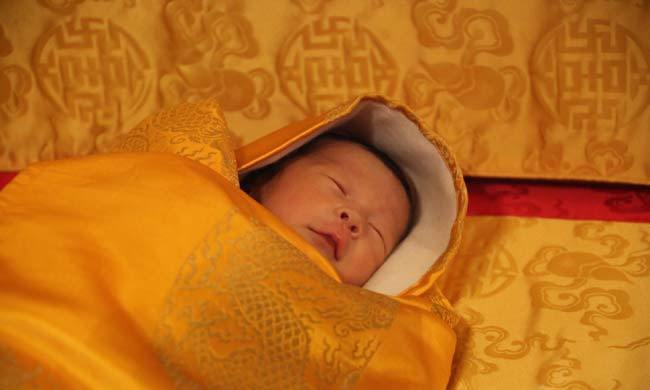 Delighted at the birth of his first child, King Jigme of Bhutan shared a picture of his four-day-old son His Royal Highness, The Gyalsey.