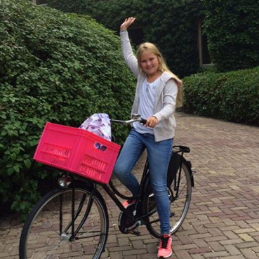 First day of school. Proud parents King Willem-Alexander and Queen Maxima celebrated Princess Amalia's first day at senior school by releasing this cute pic of her getting ready to bike to class.