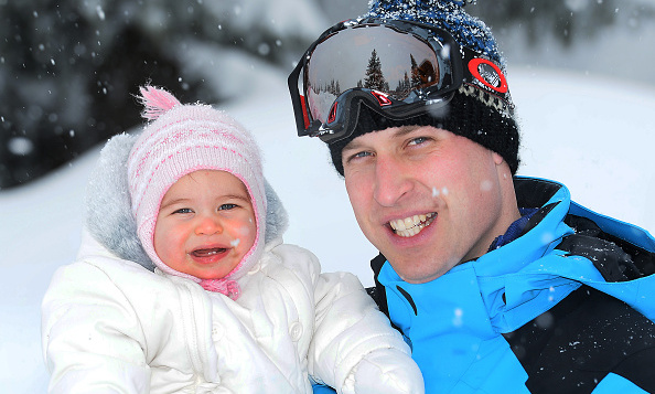 "While Charlotte resembles her mother more, the father-daughter duo could not look any sweeter in this photo. The Princess is <a href=""http://us.hellomagazine.com/royalty/12016030712465/princess-charlotte-baby-teeth-new-portrait-milestone/""><strong>growing so fast</strong></a> - her two bottom teeth are already visible in this portrait! We're sure the Duke is a very proud father.