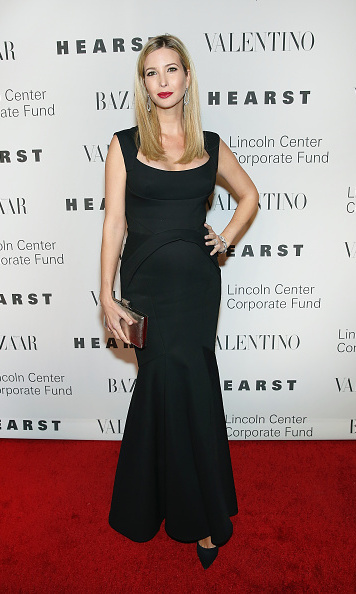 In a sleek black gown for a night in honor of designer Valentino.