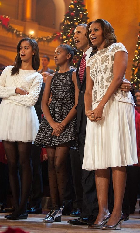 December 2013: Singing in perfect fashion! Malia and Sasha were in perfect color coordination with their parents during TNT's 'Christmas in Washington' special. 