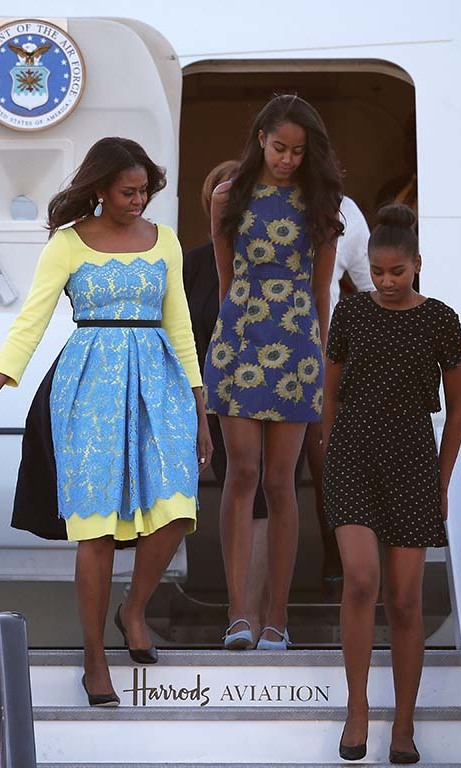 June 2015: Sasha and Malia (and their stylish mother) made a cool landing in sundresses during their trip to London. 