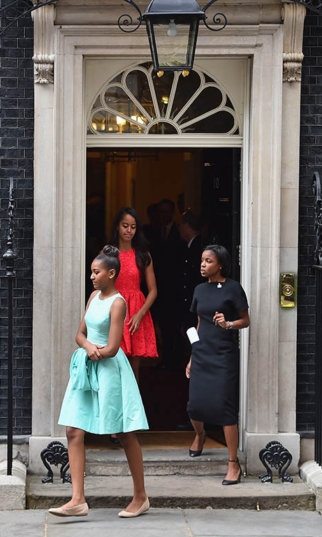 June 2015: London calling! Sasha looked elegant in pale blue, while Malia kept it cool in a coral dress during their visit with British Prime Minister David Cameron. 