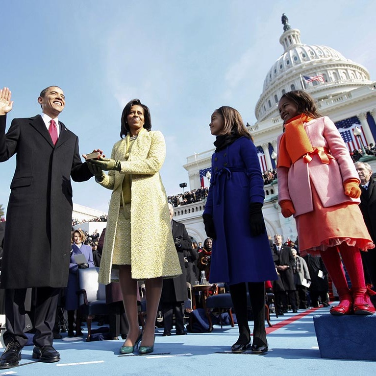 January 2009: Bright and bundled! Sasha and Malia rocked posh winter gear by J. Crew during President Obama's inauguration.