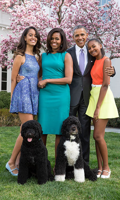 April 2015: Picture perfect! Sasha and Malia's spring style was on point during the Easter family portrait session on the Rose Garden of the White House. 