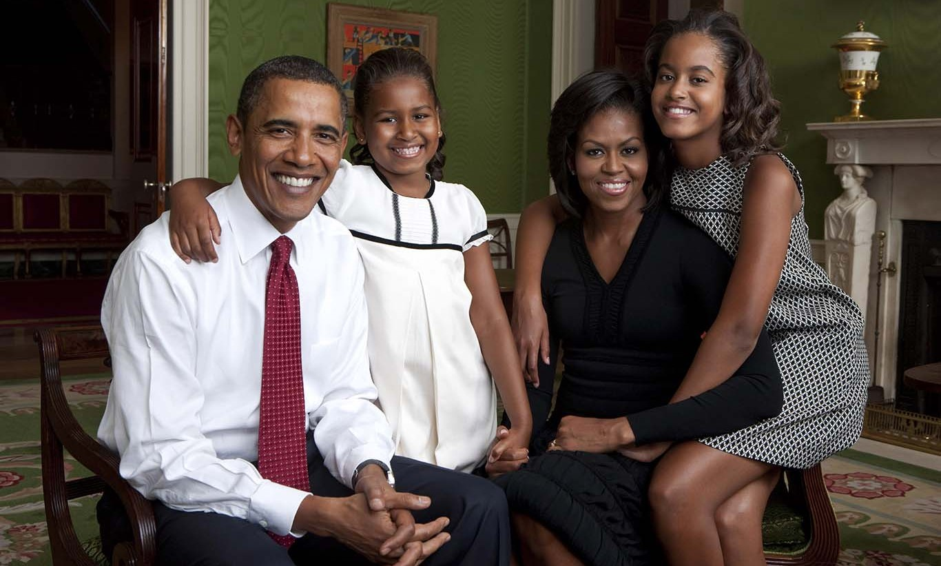September 2009: Sasha and Malia were too cute during the first family portrait session in the White House. 