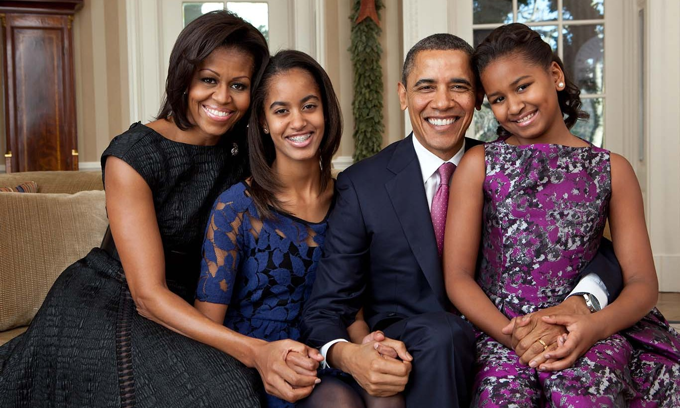 December 2011: It's obvious that the girls fashion sense has been growing with them – and mom Michelle has been a big influence. During this holiday photo session, Sasha and Malia wore more sophisticated looks that went perfectly with mom's.