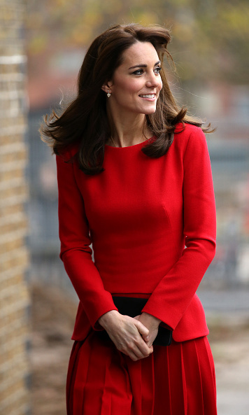 For a Christmas party at a local charity, Kate brought out a red pleated Alexander McQueen dress which she has previously worn twice before. 