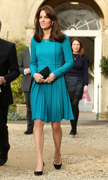 Here the royal is seen wearing her signature black pumps and a cheery dress by British designer Emilia Wickstead, a label that Duchess and her sister Pippa Middleton have worn several times. 