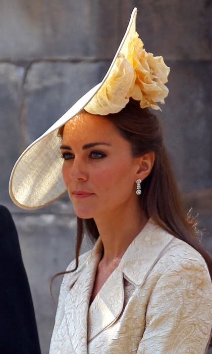 She may have recycled the outfit she wore for Zara Phillips and Mike Tindall's 2011 wedding, but Kate freshened up the ensemble by debuting an oversized headpiece designed by British milliner Gina Foster.