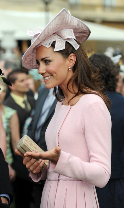 For her first-ever Buckingham Palace Garden Party, the Duchess was a picture of pink perfection in a rosy Jane Corbett hat that featured delicate lace underlay.