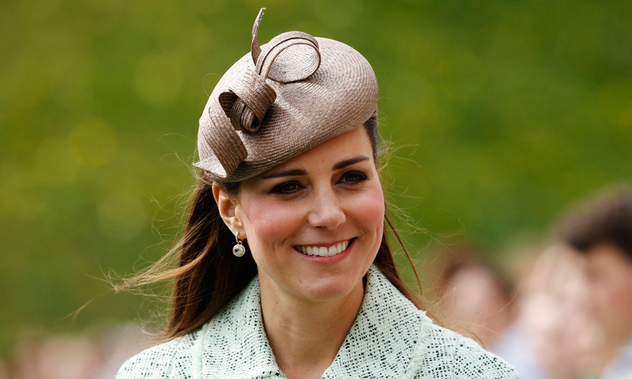 We spot a hat trick! Expectant Kate recycled her favorite straw-colored headpiece to attend the National Review of Queen's Scouts in 2013.