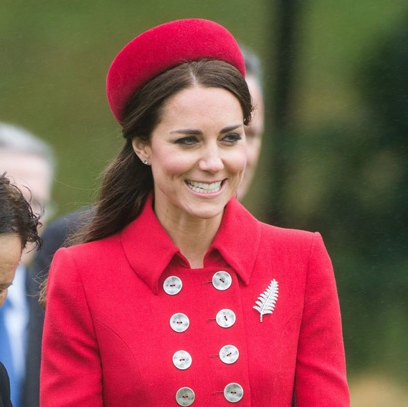 Kate looked stunning in a red Catherine Walker coat and Gina Foster hat in the same hue as she stepped out in New Zealand in 2014.