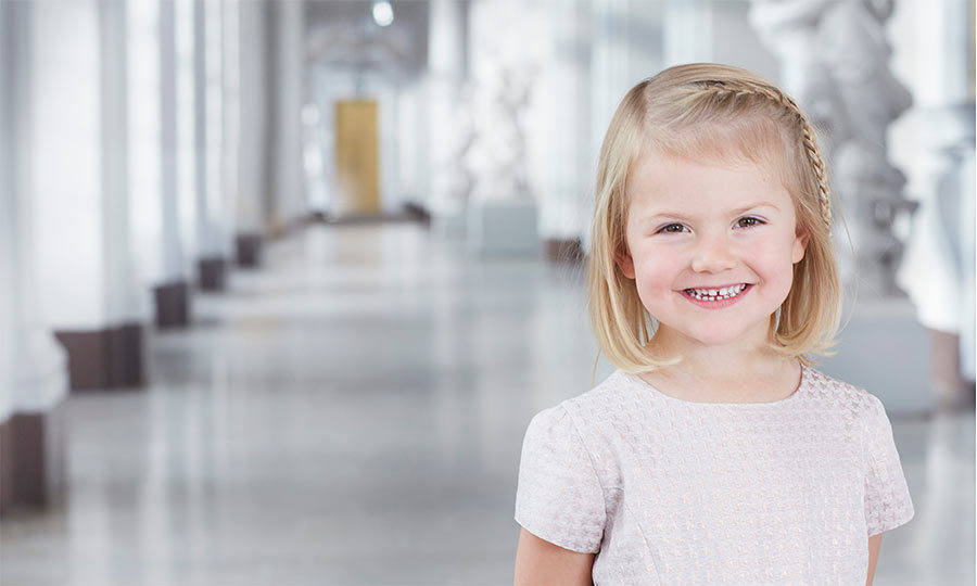 February 2016: The young princess flashed a wide smile as she posed for Swedish royal family stamps. The special-edition stamps were released in March to celebrate King Carl XVI Gustaf's 70th birthday. 