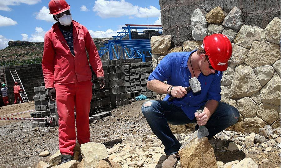 Never afraid to get his hands dirty, in 2014 the Prince helped break down some sandstone at the construction site for a new Sentebale children's center in Maseru, Lesotho. 