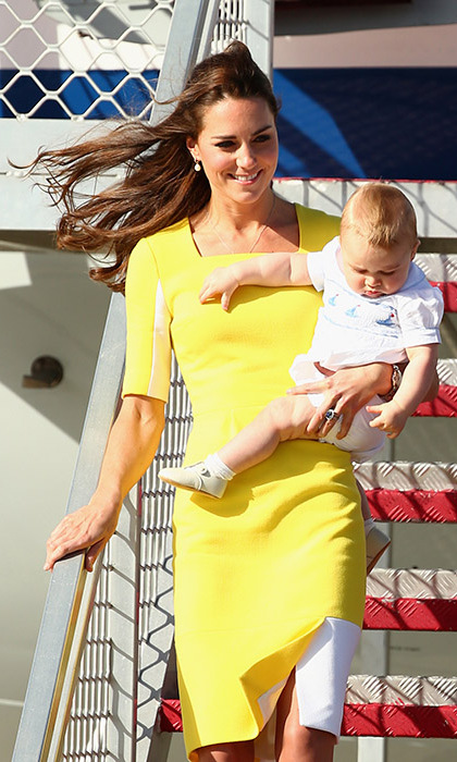 Take flight! Kate took her multi-tasking mommy duties sky high as she touched down in Australia with Prince George. 