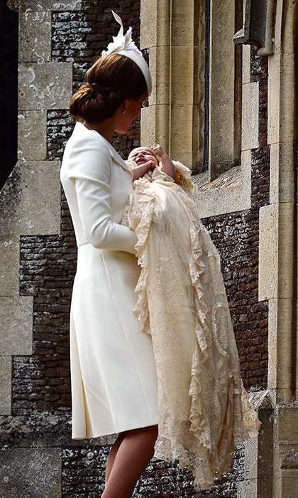 The elegant mom-of-two cradled her little Princess during her christening. 