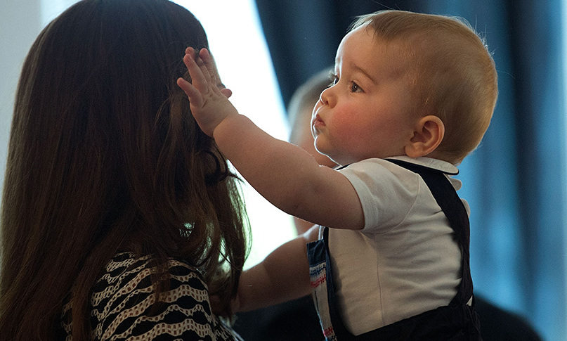 It looks like Prince George loved his mother's glossy tresses as much as we do!